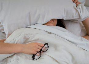 women sick in white blanket